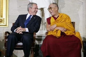 President George W. Bush and His Holiness the Dalai Lama share a laugh during the ceremony at the U.S. Capitol in Washington, D.C., for the presentation of the Congressional Gold Medal to His Holiness the Dalai Lama on 17 Oct. 2007. (Photo: Chris Greenberg/White House
