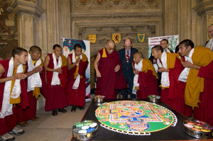 His Holiness viewing the Sand Mandala created by Tashi Lhunpo monks in the Westminster Parliament foyer. (Photo by Ian Cumming/Office of Tibet, London)